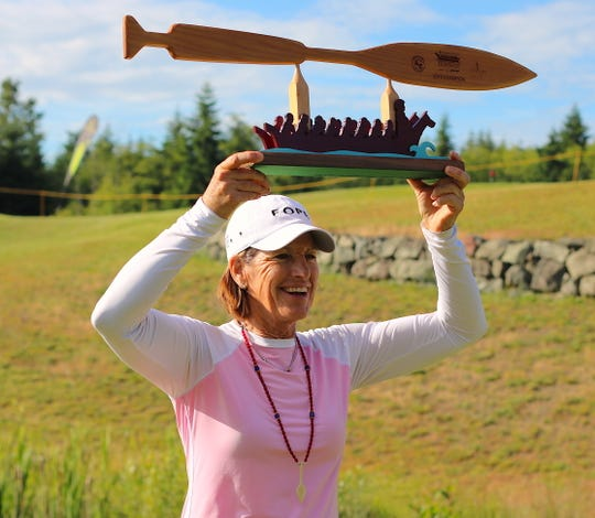 Champion Juli Inkster displays her trophy after winning the 2019 Suquamish Clearwater Legends Cup at White Horse Golf Club. Inkster shot 15-under to win the tournament by four shots.