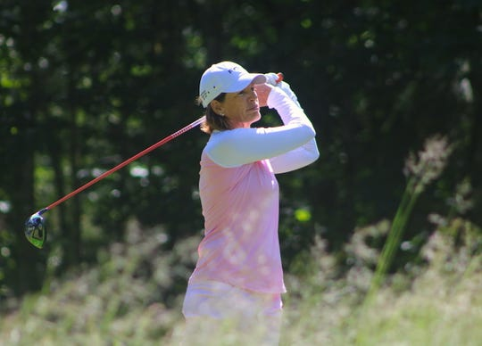 Juli Inkster watches a drive during Saturday's Suquamish Clearwater Legends Cup golf event at White Horse Golf Club.