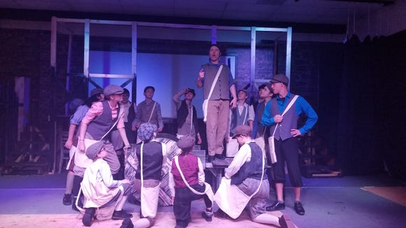 "Jack (Michael Drake, top) rallies the Newsies in Paradise Theatre's production of the Disney musical ""Newsies,"" which opens June 14 in Port Orchard."
