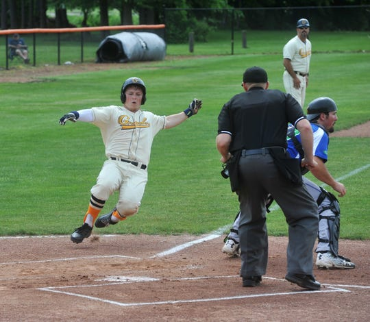 Galion Graders third baseman Andrew Sharp slides into home plate.