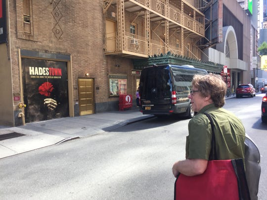 "Michael Chorney, guitarist for the musical ""Hadestown,"" heads into Walter Kerr Theatre in Manhattan on June 9, 2019."