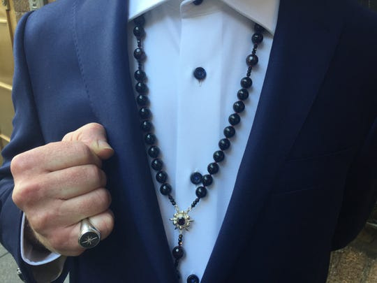 Vermont musician Michael Chorney displays jewelry designed by Donna Distefano that he wore to the Tony Awards in New York City on June 9, 2019.