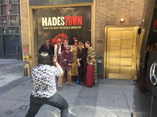 "Cherie B. Tay, assistant stage manager for the Broadway musical ""Hadestown,"" takes a photo of the band outside Walter Kerr Theatre in Manhattan on June 9, 2019. Drummer Ben Perowsky is in front. The rest of the band, from left to right, is Robinson Morse, bass; Liam Robinson, conductor and piano; Michael Chorney, guitar; Marika Hughes, cello; Brian Drye, trombone; and Dana Lyn, violin."