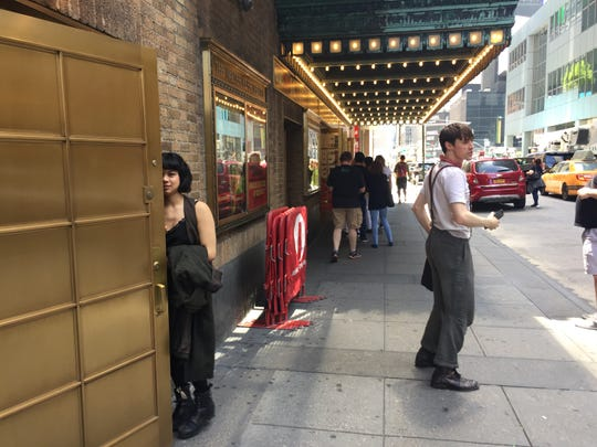 "Tony Award nominee Eva Noblezada, who portrays Eurydice in ""Hadestown,"" enters the Walter Kerr Theatre while Reeve Carney, who stars as Orpheus, turns to greet fans June 9, 2019."