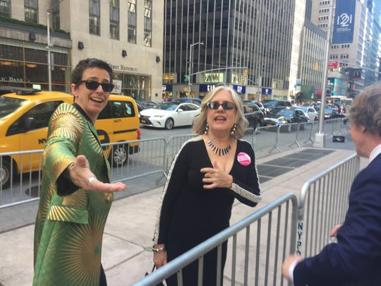 """Hadestown"" scenic designer Rachel Hauck, left, greets fellow Tony Award nominee Michael Chorney as they head to the award ceremony at Radio City Music Hall in New York City on June 9, 2019."