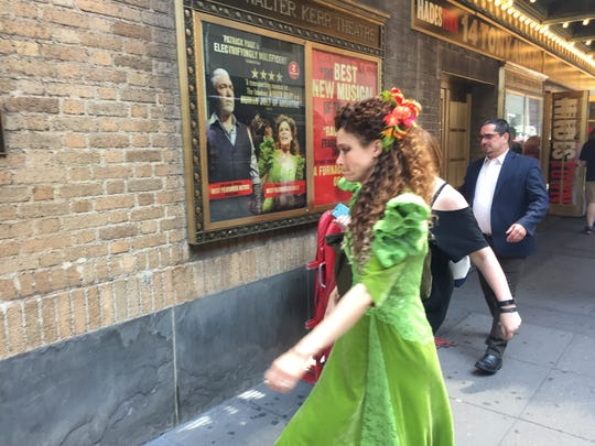 "Tony Award nominee Amber Gray, who portrays Persephone in the Broadway musical ""Hadestown,"" walks past a poster of herself at the Walter Kerr Theatre in Manhattan on June 9, 2019."