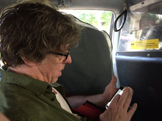 "Tony Award nominee Michael Chorney of Lincoln checks his phone June 9, 2019 in a cab from his Upper West Side apartment to the Walter Kerr Theatre, where ""Hadestown"" is staged."