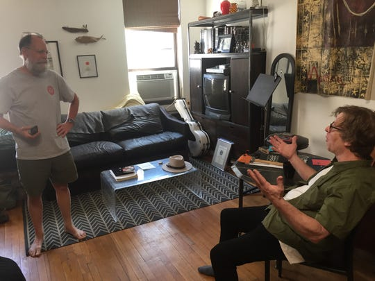 Lincoln residents Mark Mulqueen, left, and Michael Chorney, right, chat in Chorney's Upper West Side apartment June 9, 2019. Mulqueen came to Manhattan to accompany Chorney to the Tony Awards.