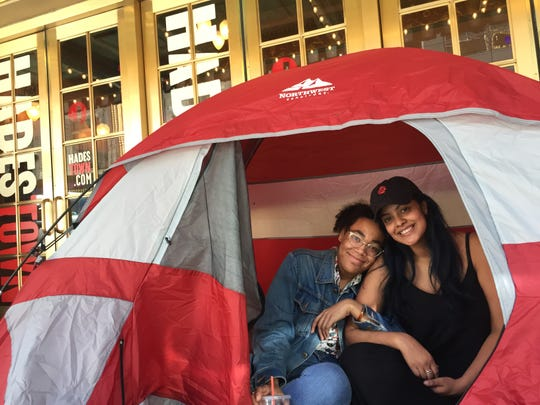 "Maria Pigotti, left, and Jeree Reyna, both of New York City, camped out in a tent in front of Walter Kerr Theatre so they could get tickets to see ""Hadestown"" on June 9, 2019, the day the Vermont-born musical was up for 14 Tony Awards."