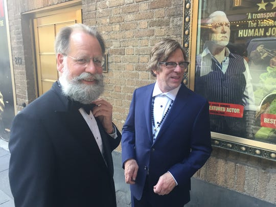 Michael Chorney, right, and his friend Mark Mulqueen, both of Lincoln, stand outside Walter Kerr Theatre in Manhattan in the suits they wore to the Tony Awards on June 9, 2019.