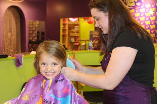 Sweet & Sassy has seat belts, TVs, toys and more to keep kids contained during a haircut. That's why parents bring boys as well as girls to the salon, one franchise owner says.