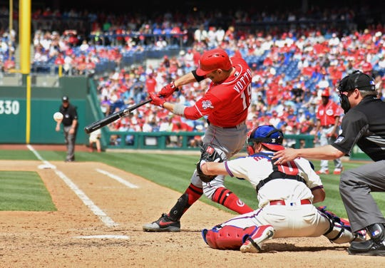 Jun 9, 2019; Philadelphia, PA, USA; Cincinnati Reds first baseman Joey Votto (19) hits an two RBI single during the seventh inning against the Philadelphia Phillies at Citizens Bank Park. Mandatory Credit: Eric Hartline-USA TODAY Sports