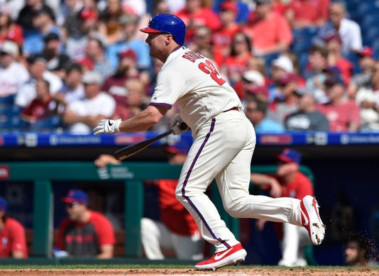 Jun 8, 2019; Philadelphia, PA, USA; Philadelphia Phillies right fielder Jay Bruce (23) watches the ball after hitting a two run RBI single during the first inning against the Cincinnati Reds at Citizens Bank Park. Mandatory Credit: Derik Hamilton-USA TODAY Sports
