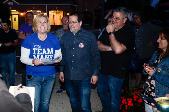 Mayor Colleen Mahr with Fanwood Dem Chairman Kevin Boris reading results with Councilman Jeff Banks, at right.