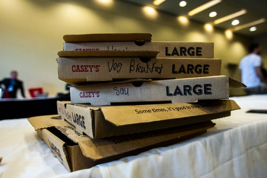 Empty boxes of Casey's breakfast, and sausage pizza sit on a table during the Iowa Democratic Party Hall of Fame dinner, Sunday, June 9, 2019, at the DoubleTree by Hilton in Cedar Rapids, Iowa.
