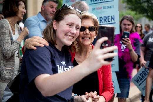 Isabelle Webber, of Marion, poses for a selfie with Elizabeth Warren, candidate for president, outside of the Iowa Democratic Party's hall of fame event on Sunday, June 9, 2019, in Cedar Rapids.