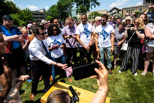 "Democratic presidential candidate Pete Buttigieg, mayor of South Bend Ind., plays bags with Demi Stratmon, 20, of Washington, D.C., during a rally, Sunday, June 9, 2019, in Cedar Rapids, Iowa. Stratmon traveled to Iowa with activists from the 51 for 51 group which looks to seek, ""full representation for the more than 700,000 residents of the District of Columbia,"" according to their website."