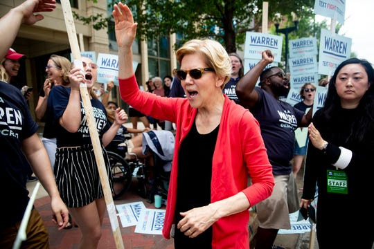 Elizabeth Warren greets the crowd of people supporting her for president outside of the Iowa Democratic Party's hall of fame event on Sunday, June 9, 2019, in Cedar Rapids.