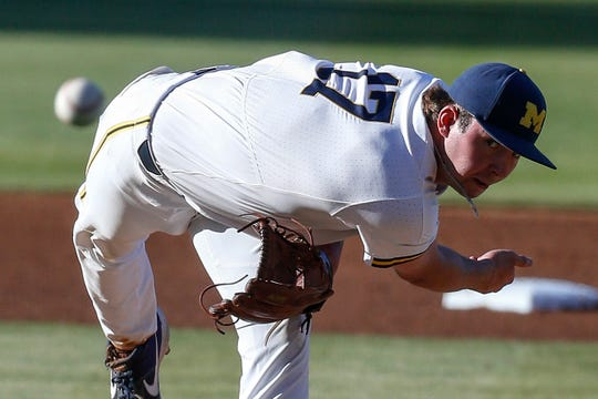 Michigan pitcher Jeff Criswell throws to a UCLA batter during the first inning of an NCAA college baseball tournament super regional game in Los Angeles, Saturday, June 8, 2019.