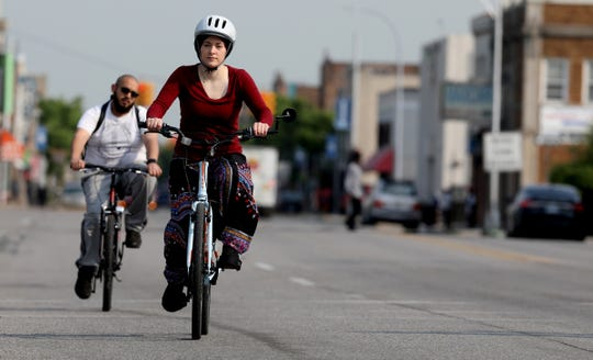 Amanda Jaczkowski heads out down Jos Campau Avenue in Hamtramck from on her bike to a meeting in Detroit on May 31. In 2017 Jaczkowski was on a bike lane on Cass Avenue in Midtown Detroit when she was run over by a gravel truck. She spent 85 days in the hospital recovering.