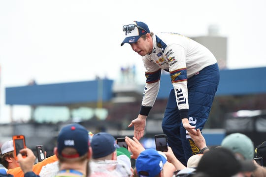 Brad Keselowski, driver of the #2 Miller Lite Ford, participates in pre-race ceremonies during the Monster Energy NASCAR Cup Series FireKeepers Casino 400 at Michigan International Speedway on June 09, 2019 in Brooklyn.