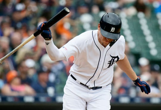 JaCoby Jones throws down his bat as he flies out against the Twins during the fifth inning at Comerica Park on Sunday.