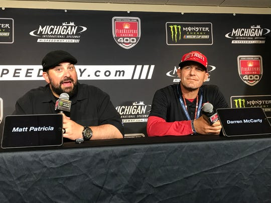 Lions coach Matt Patricia, left, and former Red Wings standout Darren McCarty speak to the media before the FireKeepers Casino 400 at Michigan International Speedway in Brooklyn, Sunday.