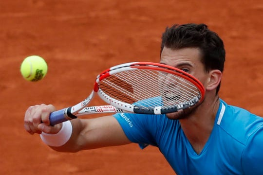 Austria's Dominic Thiem returns the ball to Spain's Rafael Nadal.