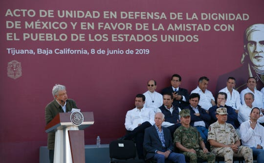Mexican President Andres Manuel Lopez Obrador speaks during a rally in Tijuana, Mexico, Saturday. The event was originally scheduled as an act of solidarity in the face of President Donald Trump's threat to impose a 5% tariff on Mexican imports if it did not stem the flow of Central American migrants heading toward the U.S