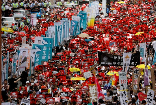A sea of protesters is marching through central Hong Kong in a major demonstration against government-sponsored legislation that would allow people to be extradited to mainland China to face charges.