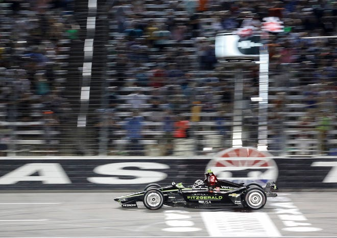 Josef Newgarden (2) crosses the finish line to win the IndyCar series race at Texas Motor Speedway.