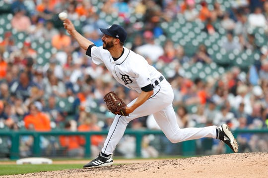 Detroit Tigers pitcher Carlos Torres throws in the sixth inning Sunday.