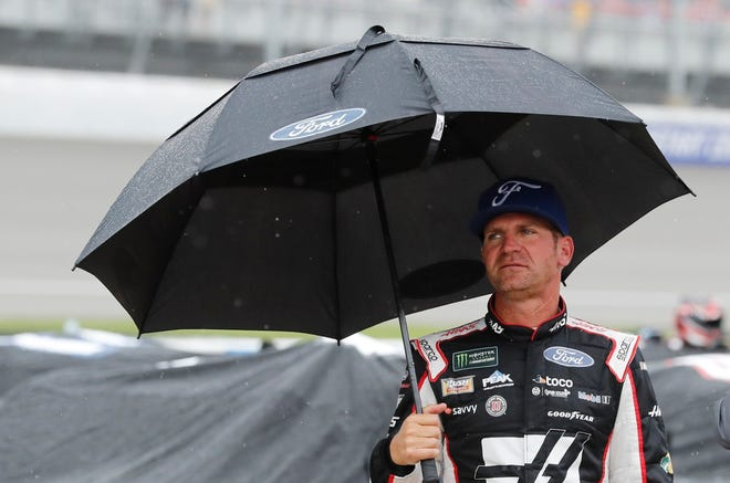 Clint Bowyer stands on pit row waiting out the rain delay Sunday.