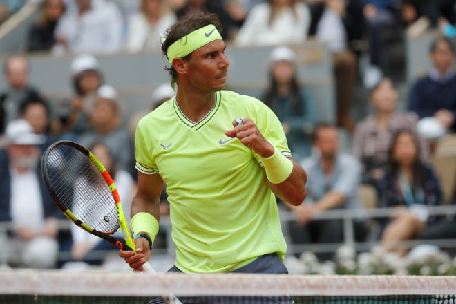 Spain's Rafael Nadal scores a point against Austria's Dominic Thiem.