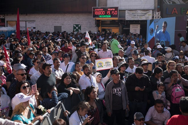 Supporters of Mexican President Andres Manuel Lopez Obrador wait for his arrival at a rally in Tijuana, Mexico, Saturday, June 8, 2019.