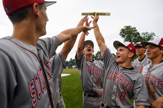 The Southridge Raiders including Ethan Bell, center left, and Tucker Schank, center right, celebrate their 7-0 win over the South Vermillion Wildcats in the IHSAA Class 2A semistates at Alvin C. Ruxer Field in Jasper, Ind., Saturday, June 8, 2019.