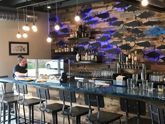 Tin Fish owner and chef Morgan Castillo at her beautiful blue bar at the new Tin Fish in Newburgh.