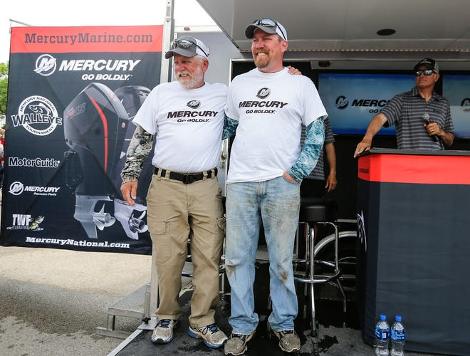 Kurt Stobbe and his son, Mathew, of Berlin, Wis. are announced the winners of the Mercury Marine National Walleye Tournament on Sunday, June 9, 2019 at Walleye Weekend in Lakeside Park in Fond du Lac, Wis. The duo weighed in just over 36 pounds of fish to win the two-day tournament.