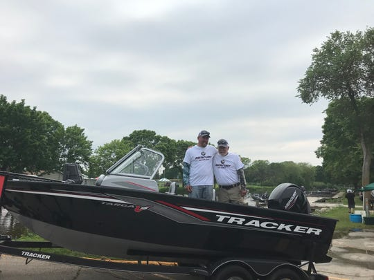 Mathew and Kurt Stobbe stand in their new boat, a new Tracker Targa V-18 WT with a Mercury Marine 150-horsepower Four Stroke motor, which they won in the Mercury Marine National Walleye Tournament.