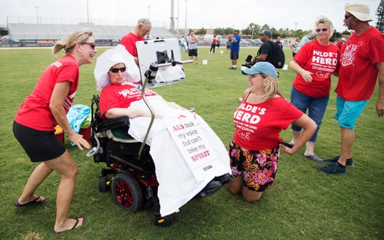 More than 200 people took the ice bucket challenge on Sunday at Cape Coral High School in an effort to raise awareness for ALS — Lou Gehrig's disease. Cre8 Salon & Spa hosted the event in honor of Hilde Heard, center, a longtime client of the salon, who has ALS.