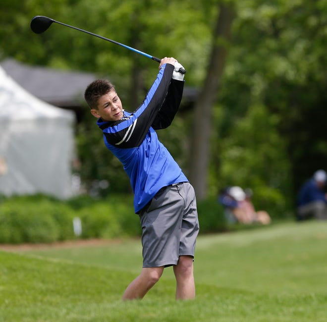 Will Sherman of Oconto High School hits his ball June 3 during the WIAA 2019 Division 3 boys state golf meet at University Ridge Golf Course in Verona.