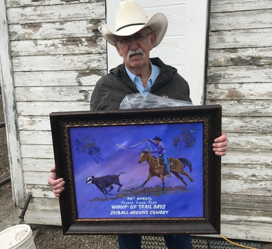 Another part of the Whoop Up Days Rodeo is Conrad artist Bob Moritz, shown holding the painting awarded to the All-Around Cowboy at the rodeo. The portrait went to Gerald Eash of Trego, who who the Bull Riding and Saddle Bronc.