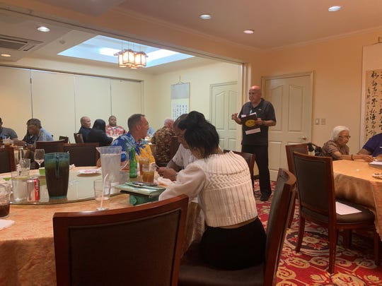 Marianas Sports Officials Association president John Benavente goes over some items on the agenda during the 2019 MSOA annual membership meeting, June 8, 2019. The meeting was held at the VIP House Chinese restaurant in Tumon.