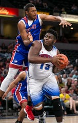Ben Davis Dawand Jones (13) pushes for a layup against Kentucky's Isaiah Cozart (9) during the Indiana All-Stars vs. Kentucky All-Stars game, Saturday, June 8, 2019, at Bankers Life Fieldhouse, Indianapolis.