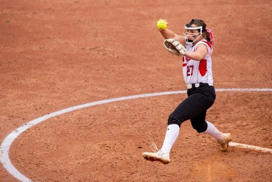 New Palestine High School sophomore Sam Booe (27) delivers a pitch. New Palestine High School took on Yorktown High School, Saturday, June 8, 2019, in the 35th Annual IHSAA Class 3A Softball State Finals at Bittinger Stadium on the campus of Purdue University in West Lafayette, Ind. New Palestine won the game 10-0.