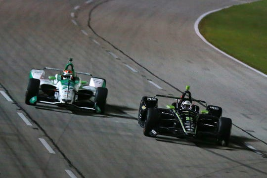 Josef Newgarden (right) held off late charges from Alexander Rossi (left) to capture the DXC Technology 600 on Saturday.