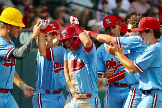 Grae Kessinger celebrates a home run he hit in the seventh inning of Ole Miss' Super Regional win against Arkansas on June 6, 2019.