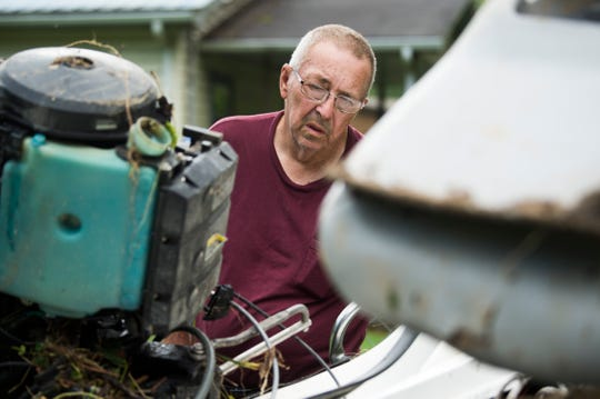 Benny Wells looks at his boat which got washed away in flood waters in LaFollette, Tennessee on Sunday, June 9, 2019. Several inches of rain fell in a matter of hours Friday night causing a building on Well's father's property to get washed away along with thousands of dollars of belongings.