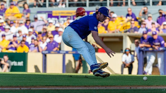Landon Marceaux fields a ball as The LSU Tigers take on the Florida State Seminoles for game 2 of the 2019 NCAA Baton Rouge Super Regional. Sunday, June 9, 2019.