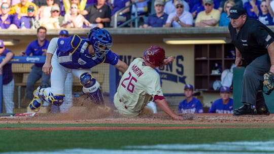 Seminoles Robby Martin slides into home as Tigers catcher Saul Garza lays down the tag as The LSU Tigers take on the Florida State Seminoles for game 2 of the 2019 NCAA Baton Rouge Super Regional. Sunday, June 9, 2019.